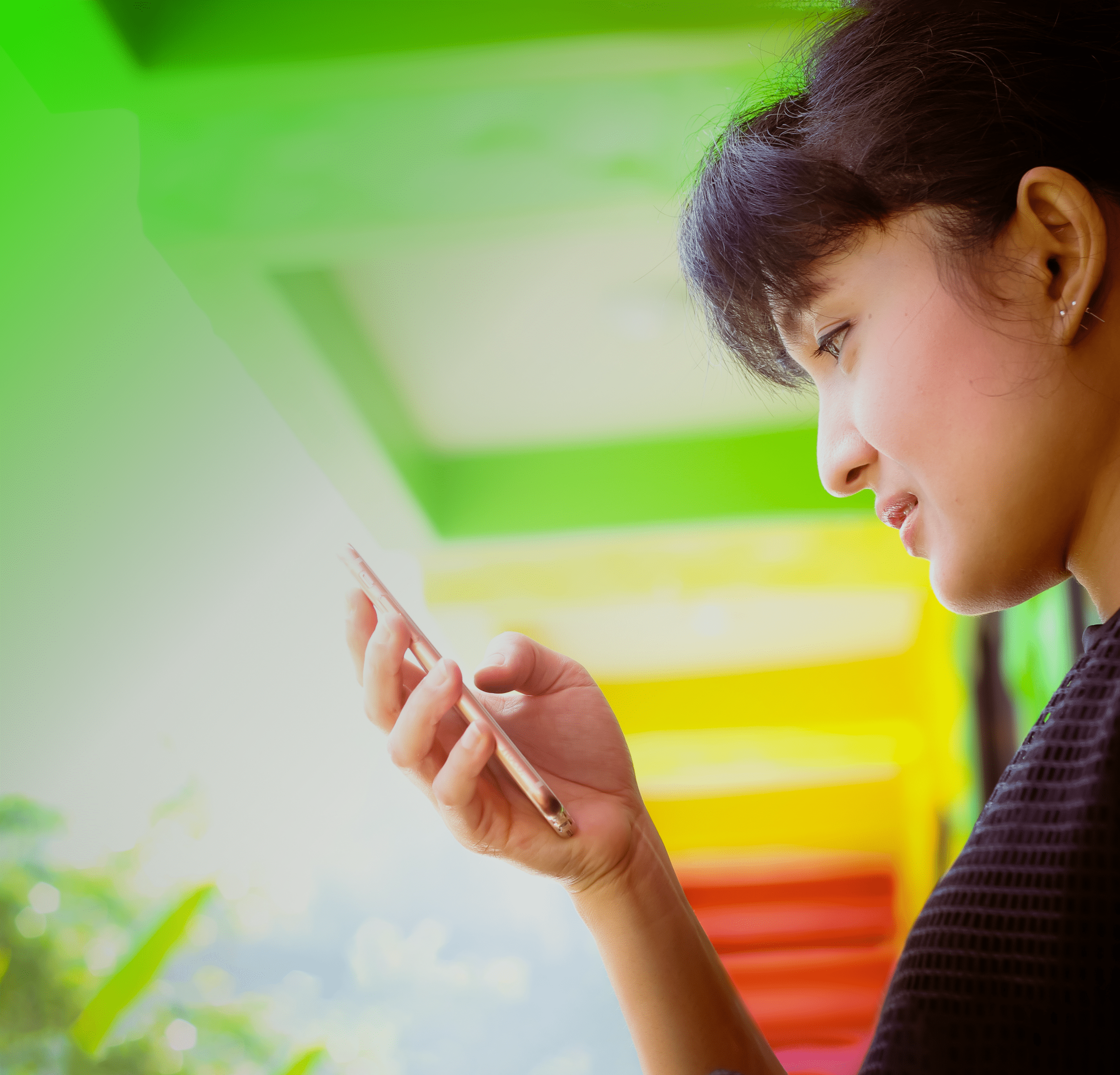 brand-hero_Happy young Asian woman with smartphone_@2x@2x